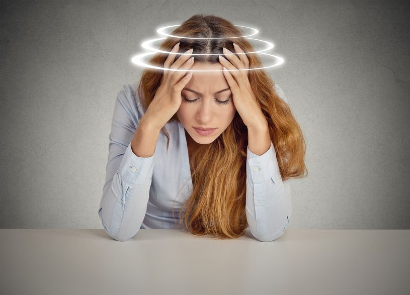 37534697 - woman with vertigo. young female patient suffering from dizziness.